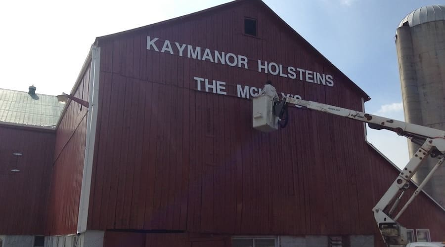 Repainting name on barn